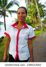 BIG CORN ISLAND, NICARAGUA-MARCH 15: A pretty Nicaraguan lady with a gold tooth works as a waitress at Casa-Canada Resort on grounds of Big Corn Island, Nicaragua, Central America on March 15, 2018.