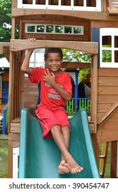 BIG CORN ISLAND, NICARAGUA-NOV. 15: Unidentified boys have fun in child's playhouse in Big Corn Island, Nicaragua, Central America on November 15, 2015.
