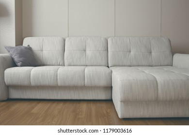 Big couch in the apartment drawing-room.