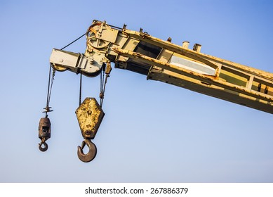 Big crane with blue sky background