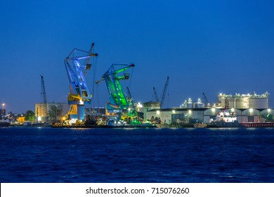 Big cranes in the evening in the port of Amsterdam the Netherlands.