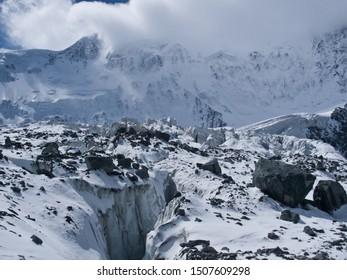 Big crevasse on the  glacier. Akkem Valley. In the background is Belukha Mountain. Russia, Siberia, Altai, Katunsky ridge
