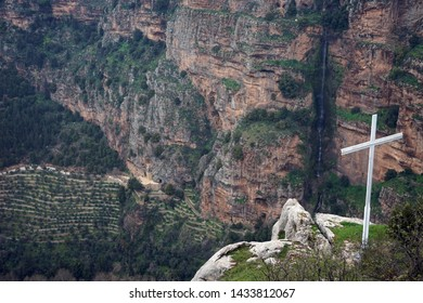 Big cross and Deir Mar Elisha monastery in Quadisha valley