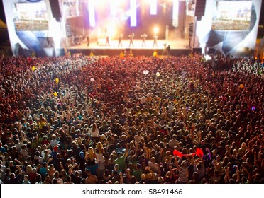 big crowd before stage at a live concert of a famous rockband