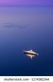 big cruise ship alone in the sea. night scene