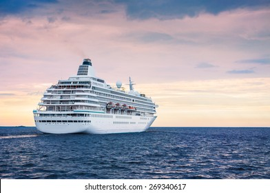 Big cruise ship in the sea at sunset. Beautiful seascape