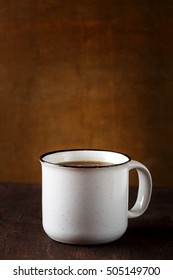 Big cup of tea on wooden background. Vintage cup. Copy space, selective focus