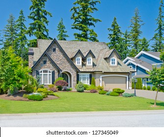 Big custom made double doors garage luxury house in the suburbs of Vancouver, Canada.
