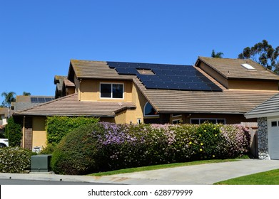 Big custom made luxury house with solar panels on the roof, nicely trimmed and landscaped front yard in the Del Mar City, California.