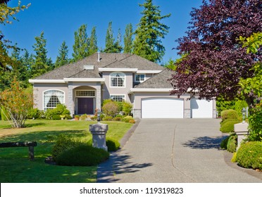 Big custom made three garage doors luxury house in the suburbs of Vancouver, Canada.