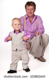Big Daddy and the little boy in business suits.