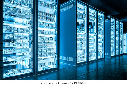Big data dark server room with bright blue equipment