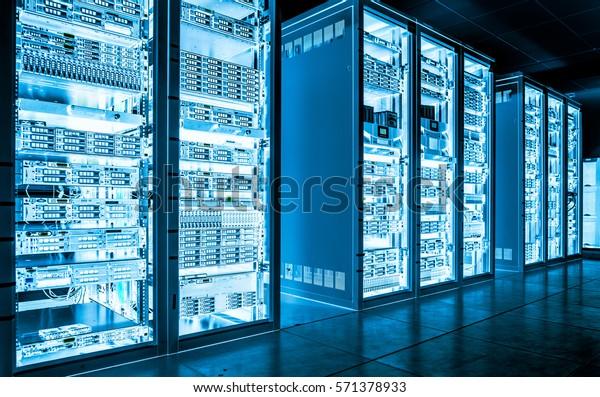 Big data dark server room with bright blue equipment