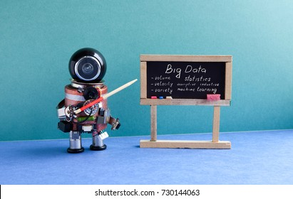 Big data machine learning concept. Robot professor explains modern theory. Teacher with a pointer near chalkboard, main topics handwritten. Blue green interior classroom.