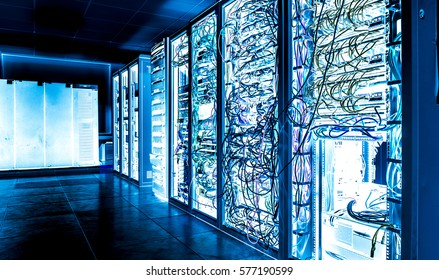 Big datacenter with connected servers and internet cable infrastucture. In blue bright tones