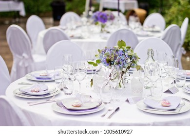"The Big Day - outdoor ""Scandinavian style"" wedding party in old abandoned greenhouse with white tablescloths, white chairs and fresh nature decorations."