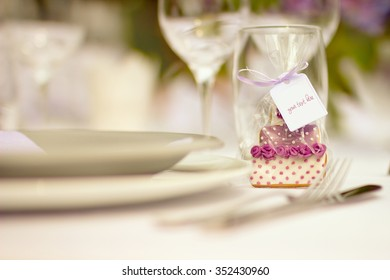 "Big day - wedding cake decoration with ""your text here"" label on white tablecloth"