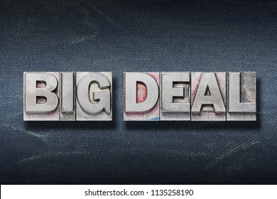 big deal phrase made from metallic letterpress on dark jeans background