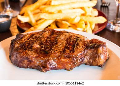 a big delicious steak with french fried