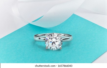 Big Diamond Ring on Tiffany Blue Background