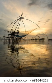 the big dip net, fishing environment bamboo and net by fisherman in morning at southern of Thailand