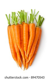 Big Discrete carrot - Heap of carrots in a shape of large root-crop. Isolated on a white.