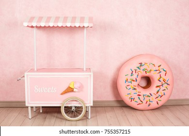 Big donut on pink background candy sweet table fair birthday decoration