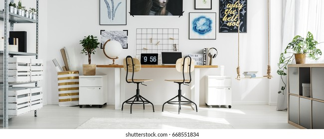 Big, double desk at stylish home office