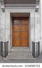 Big Double Wooden Doors at Building Corner