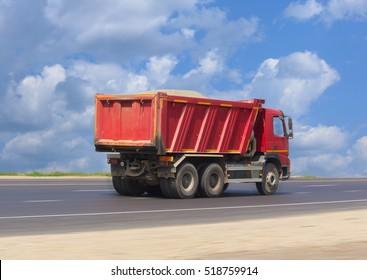 big dump truck goes on highway