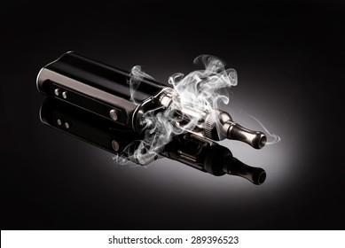 big electronic cigarettes isolated on black