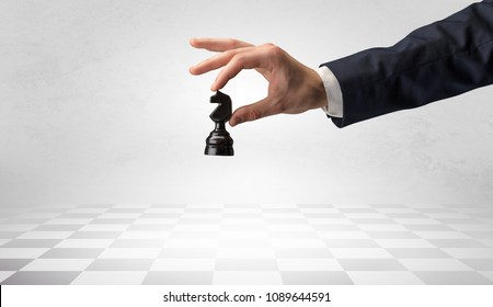 Big elegant hand taking his next step on chess game