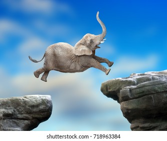 Big Elephant jumping over a gap. Successful business metaphor and jump to new year concept.