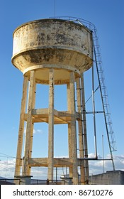 Big emergency water tank elevated over a mortar structure