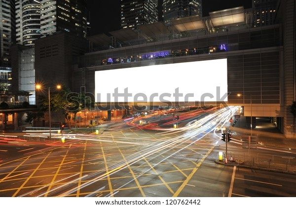 Big Empty Billboard at night in city with busy traffic