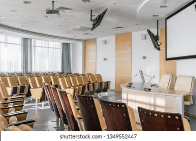Big empty modern conference hall in luxury hotel. Audience for Speakers at Business convention and Presentation. Photo for illustration meeting, seminar, conference