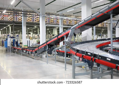 Big empty modern workshop with conveyors for sorting of goods