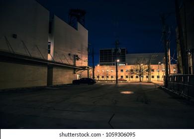 Big empty urban city parking lot at night