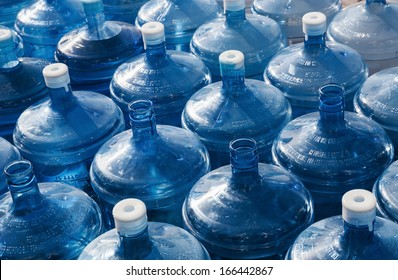 big empty water bottles in a row
