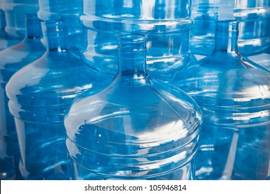 big empty water bottles at warehouse