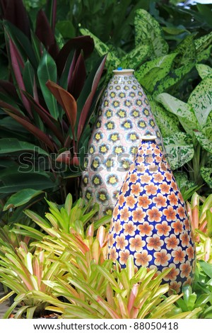 Big enameled vase pretty flower patterns stock photo edit now big enameled vase with pretty flower patterns decorating the garden surrounded by bromeliad plant mightylinksfo