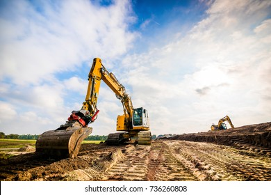 Big excavator in construction site