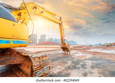 Big excavator on new construction site