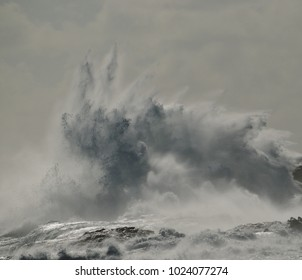 Big explosion of water, wave breaking against the rocks, coast of Gran canaria