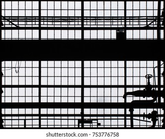 big factory window wall in the industrie museum brandenburg.  straight lines and a water tap.
