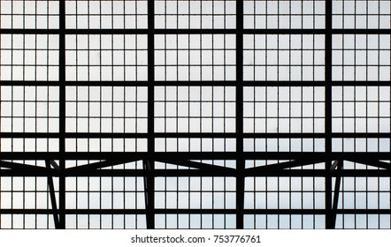 big factory window wall in the industrie museum brandenburg. straight lines. light and shadow.
