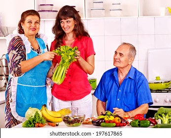 Big family cooking at kitchen. Grandfather and grandmother.