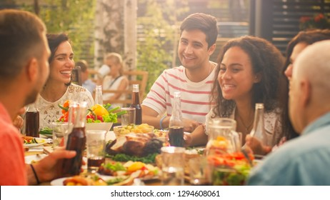Big Family Garden Party Celebration, Gathered Together at the Table Relatives and Friends, Young and Elderly are Eating, Drinking, Passing Dishes, Joking and Having Fun.