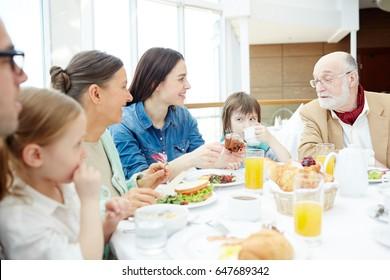 Big family having breakfast or dinner