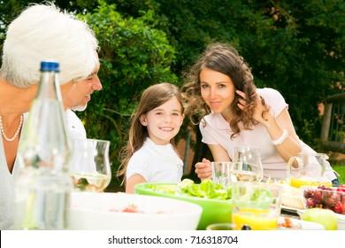 Big Family Having A Picnic In The Garden